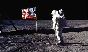 Astronaut walks on moon by planted US flag