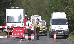 Police road block at the site near Yateley Heath, Minley, near Fleet in Hampshire