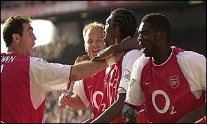 Kanu is congratulated by his Arsenal team-mates