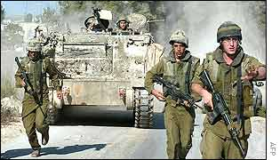 Troops run towards the Ramallah HQ of Mr Arafat