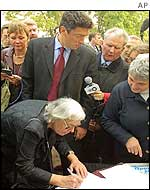 Lyudmila Alexeyeva, a human rights advocate, signs a petition against the restoration