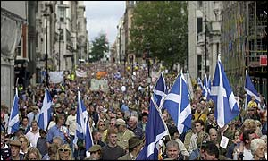 Protesters waving saltires