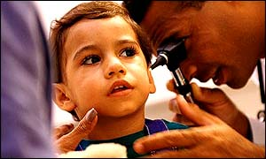 Child receives examination from doctor