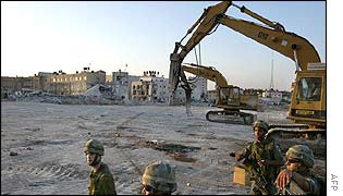 Israeli troops in the razed Ramallah compound