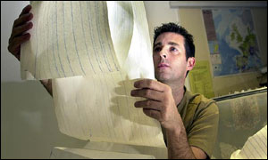 Julian Bukits, of the British Geological Survey in Edinburgh, looks over a chart