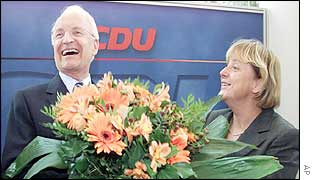 Stoiber receives a bouquet from CDU leader Angela Merkel