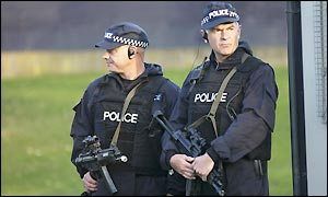 Armed police guard the gates to the course as part of a huge security opeartion
