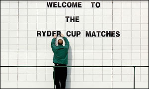 A member of staff prepares the scoreboard