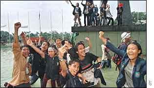 Students celebrate the downfall of President Suharto in 1998