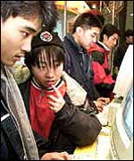 Teenagers using a PC