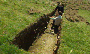Archaeologists in Exmoor trench