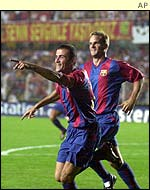 Luis Enrique and Frank de Boer of Barcelona celebrate the former's goal in the 2-0 win over Galatasary