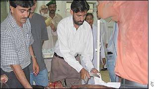 Medical personnel at a Karachi hospital attend to one of the wounded men evacuated after the attack