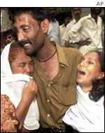 A family grieves after the attack in Karachi