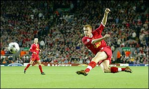 Riise strikes the ball venomously but he is denied by the crossbar