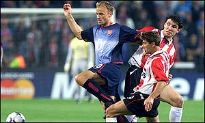 Bergkamp works hard to hold onto possession for the Gunners