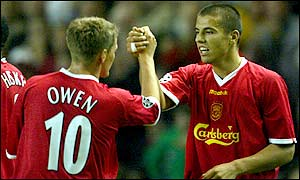 Baros takes the congratulations of his strike partner Michael Owen