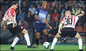 Thierry Henry takes on the PSV Eindhoven defence