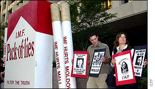 Protestors outside IMF headquarters protest tobacco sales in emerging nations.