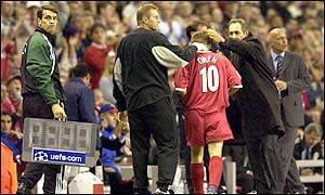 Michael Owen is comforted by the Liverpool bench after being replaced by Patrick Berger in the second half
