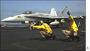 Jet takes off from USS Abraham Lincoln
