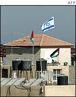 Israeli flag flying from building in Yasser Arafat's compound