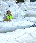 Man stacks the building site bags