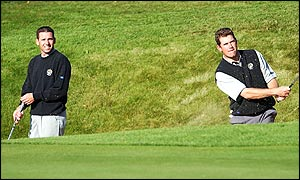 Sergio Garcia and Lee Westwood in a bunker on the 13th hole