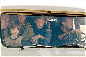 A family in their car flees from their village of Galashki. AFP