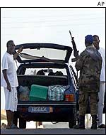 Rebel fighters at a roadblock in Bouake