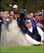 David Duval plays out of a bunker