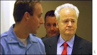 Milosevic enters the courtroom