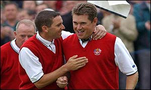 Sergio Garcia and Lee Westwood celebrate victory and Europe's first point