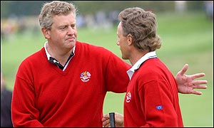 Montgomerie and Langer embrace each other in delight after their win puts Europe into a 3-0 lead