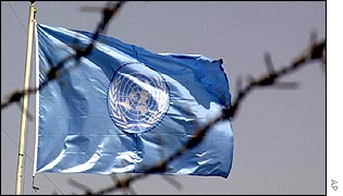 UN flag flies behind barbed wire in the UN compound in Baghdad