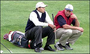 Tiger Woods reflects after he and Mark Calcavecchia are beaten by Sergio Garcia and Lee Westwood
