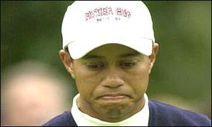 Tiger Woods looks disappointed with himself as he suffers a second defeat