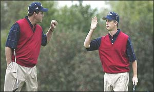 Phil Mickelson and David Toms celebrate winning a hole