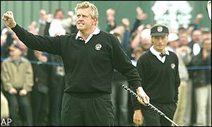 Colin Montgomerie shows his joy at putting Europe into a one point lead after he holes a putt on the 18th