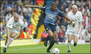 Kanu breaking forward for Arsenal during their 4-1 win at Leeds