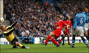 Michael Owen punishes poor defending with a clinical finish past Peter Schmeichel