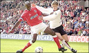 Rufus and Solskjaer tussle for the ball at the Valley