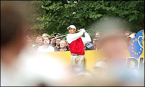 Tiger Woods tees off at the eighth hole as the tension mounts in a close battle against Sergio Garcia and Lee Westwood