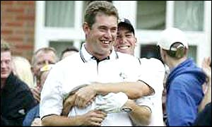 Lee Westwood is congratulated by Sergio Garcia after pulling off a stunning shot at the tenth