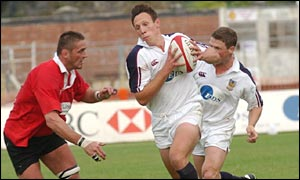 Swansea centres Mark Taylor and Scott Gibbs break through