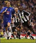Birmingham's Robbie Savage (left) and Lomana Lua Lua of Newcastle race for the ball at St Andrews