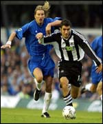 Robbie Savage of Birmingham tries to hold back Andy Griffin