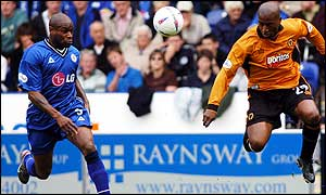 Frank Sinclair (left) and Dean Sturridge compete for the ball