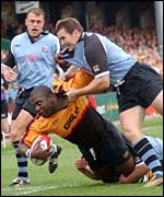 Newport's Steve Ojomoh is brought down