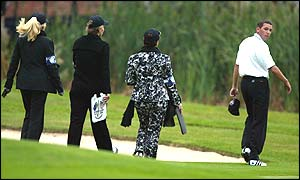 Sergio Garcia of the European team is followed from the 18th green by his mother